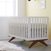 Norfolk 3-in-1 Convertible Crib in Creme - Side View Room Photo